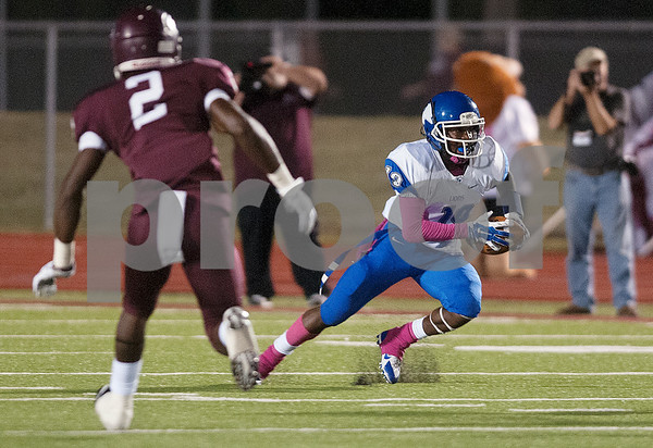 photo by Sarah A. Miller/Tyler Morning Telegraph  John Tyler High School's Duntayviun Gross (19) carries the ball in the first half of their game against Ennis High School Friday Oct. 17, 2014 at Lion Memorial Stadium in Ennis.