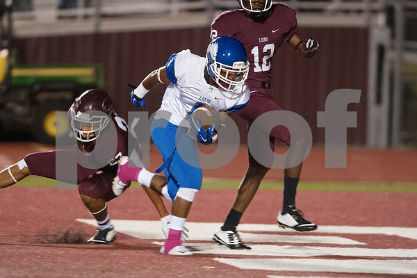 photo by Sarah A. Miller/Tyler Morning Telegraph  Ennis High School's Marqus Monroe (27) and Davante Edwards (12) can't stop John Tyler's (1) Jeremy Wilson from scoring a touchdown during their game Friday Oct. 17, 2014 at Lion Memorial Stadium in Ennis.