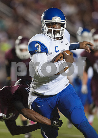 photo by Sarah A. Miller/Tyler Morning Telegraph  John Tyler's (3) Geovari McCollister is tackled by Ennis' Trey Edwards (24) during their game Friday Oct. 17, 2014 at Lion Memorial Stadium in Ennis.