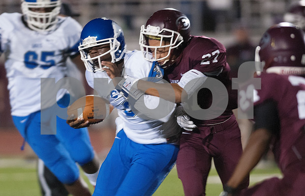 photo by Sarah A. Miller/Tyler Morning Telegraph  John Tyler's (3) Geovari McCollister is stopped by Ennis' Marqus Monroe (27) during their game Friday Oct. 17, 2014 at Lion Memorial Stadium in Ennis.