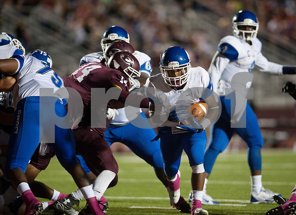 photo by Sarah A. Miller/Tyler Morning Telegraph  John Tyler's Jeremy Wilson (1) gains yards in the second half of their game against Ennis Friday Oct. 17, 2014 at Lion Memorial Stadium in Ennis.