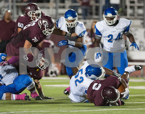 photo by Sarah A. Miller/Tyler Morning Telegraph   John Tyler's (52) Braylon Jones tackles Ennis' Taylor Thompson (3) during their game against Ennis Friday Oct. 17, 2014 at Lion Memorial Stadium in Ennis.