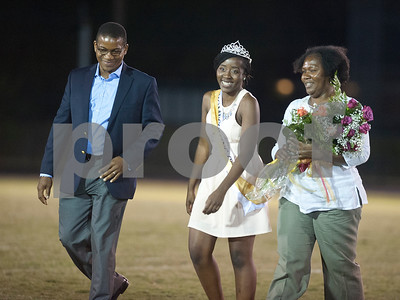 Senior Similoluwa Oyefeso is escorted by her parents after being crowned homecoming queen at Friday's homecoming game at McCallum Stadium in Tyler.   (Sarah A. Miller/Tyler Morning Telegraph)