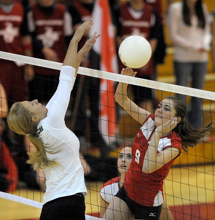 Fairview's Alison Yardley (right) spikes the ball past Monarch's Kendall Peterson (left) during their volleyball game at Fairview High School in Boulder, Colorado October 18, 2011.  CAMERA/Mark Leffingwell