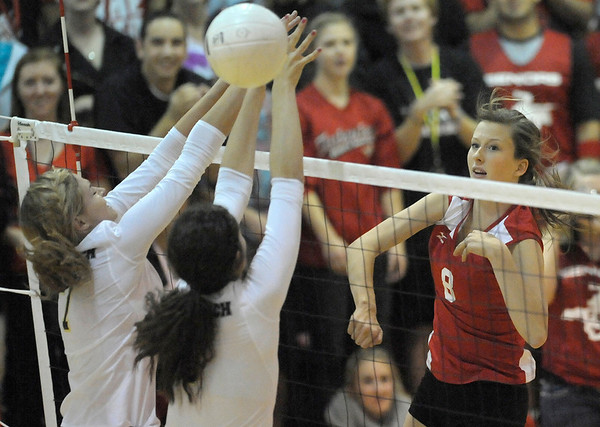 Fairview's Kendall LaVine (left) gets the ball past Monarch's Addy Loftsted (left) and Willow Brook (middle) during their volleyball game at Fairview High School in Boulder, Colorado October 18, 2011.  CAMERA/Mark Leffingwell