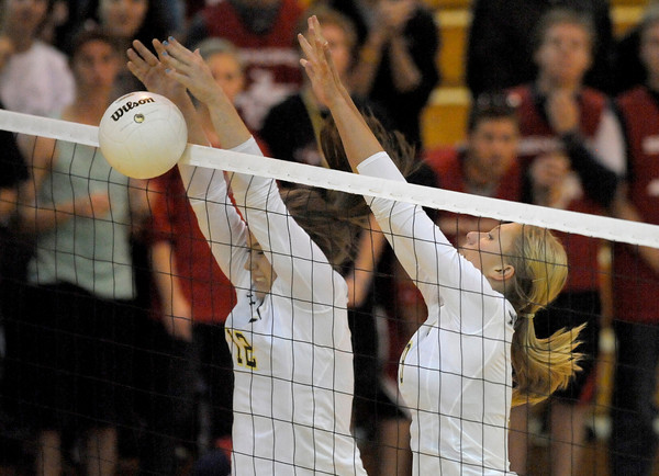 Monarch's Hanna Safari (left) and Kendall Peterson (right) block a shot from Fairview during their volleyball game at Fairview High School in Boulder, Colorado October 18, 2011.  CAMERA/Mark Leffingwell