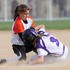 Erie's Kaitlyn Glaze (left) misses the tag on Mountain View's Madi Shawver (right) during their 2012 State Softball game in Auroa, Colorado October 19, 2012. BOULDER DAILY CAMERA/ Mark Leffingwell