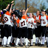 Erie surrounds teammate Amanda Ochoa after she hit a home run against Mountain View during their 2012 State Softball game in Aurora, Colorado October 19, 2012. BOULDER DAILY CAMERA/ Mark Leffingwell