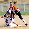 Erie's Kaitlyn Glaze (right) tags out Mountain View's Courtney Baekel (right) at 2nd base during their 2012 State Softball game in Aurora, Colorado October 19, 2012. BOULDER DAILY CAMERA/ Mark Leffingwell