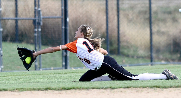 Erie's Jenna VanLone makes a diving catch against Ponderosa during their 2012 State Softball game in Aurora, Colorado October 19, 2012. BOULDER DAILY CAMERA/ Mark Leffingwell