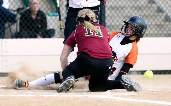 Erie's Kenzie Kudrna (right) beats the throw to Ponderosa's Ally Power (left) to score during their 2012 State Softball game in Aurora, Colorado October 19, 2012. BOULDER DAILY CAMERA/ Mark Leffingwell