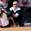 Loveand's Colissa Bakovich (left) beats the tag from Cherokee Trail's Darina Higens (right) during their 2012 State Softball game in Aurora, Colorado October 19, 2012. BOULDER DAILY CAMERA/ Mark Leffingwell