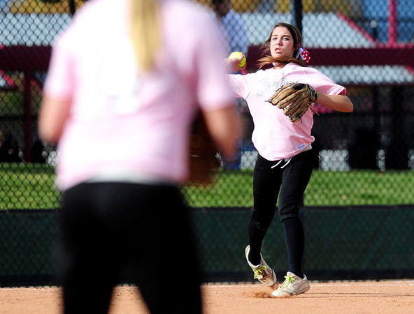 Loveland's Braydee Bakovich (right) makes the throw to Holly Posegate (left) for the out against Cherokee Trail during their 2012 State Softball game in Aurora, Colorado October 19, 2012. BOULDER DAILY CAMERA/ Mark Leffingwell