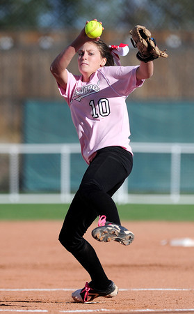 Loveland's Cassidy Smith winds up to pitch against Cherokee Trail during their 2012 State Softball game in Aurora, Colorado October 19, 2012. BOULDER DAILY CAMERA/ Mark Leffingwell