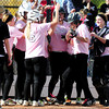 Loveland's Cassidy Smith is congratulated by her team after hitting a home run against Cherokee Trail during their 2012 State Softball game in Aurora, Colorado October 19, 2012. BOULDER DAILY CAMERA/ Mark Leffingwell