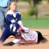 Loveland's Tes Hass (right) is tagged out at 2nd base by Cherokee Trail's Lyndsey Knabenshue (left) during their 2012 State Softball game in Aurora, Colorado October 19, 2012. BOULDER DAILY CAMERA/ Mark Leffingwell