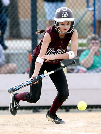 Berthoud's Sami Kouns bunts down the first base line against Niwot during their 2012 State Softball game in Aurora, Colorado October 19, 2012. BOULDER DAILY CAMERA/ Mark Leffingwell