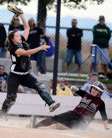 Berthoud's Lindsey Carlin (right) beats the throw to Niwot's Katrina Hunt (left) to score during their 2012 State Softball game in Aurora, Colorado October 19, 2012. BOULDER DAILY CAMERA/ Mark Leffingwell