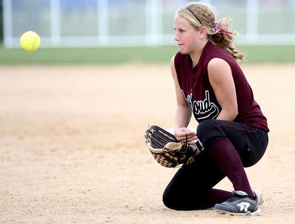 Bethoud's Kendall Baker stops a ground ball against Niwot during their 2012 State Softball game in Aurora, Colorado October 19, 2012. BOULDER DAILY CAMERA/ Mark Leffingwell