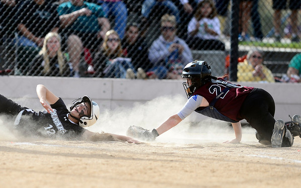Niwot's Bailey Kleespies (left) is tagged out at home by Berthoud's Kenzie Keller (right) during their 2012 State Softball game in Aurora, Colorado October 19, 2012. BOULDER DAILY CAMERA/ Mark Leffingwell