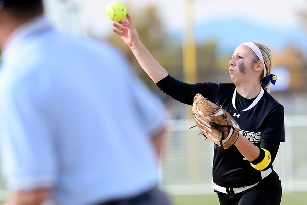 Niwot's Taylor Supino makes the throw to first for an out against Berthoud during their 2012 State Softball game in Aurora, Colorado October 19, 2012. BOULDER DAILY CAMERA/ Mark Leffingwell