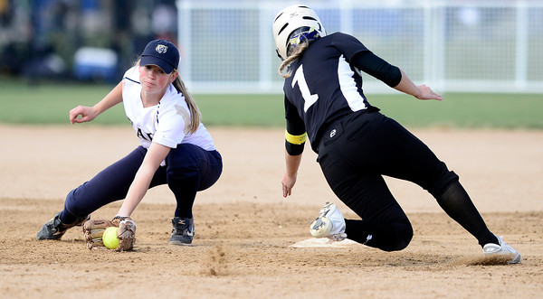Niwot's Taylor Supino (right) beats the throw to Palmer Ridge's Jen Tarwater (right) but is tagged out after sliding past second base during their 2012 State Softball game in Aurora, Colorado October 19, 2012. BOULDER DAILY CAMERA/ Mark Leffingwell