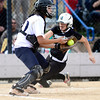 Niwot's Katrina Hunt (right) beats the throw to Palmer Ridge's Taylor Lee (left) to score a run during their 2012 State Softball game in Aurora, Colorado October 19, 2012. BOULDER DAILY CAMERA/ Mark Leffingwell