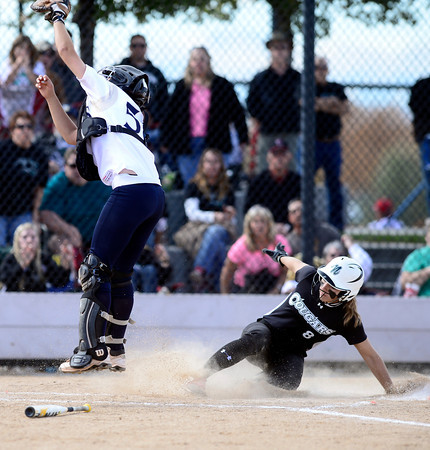 Niwot's Meghan Waidler (right) slides safely into home behind Palmer Ridge's Taylor Klee (left) during their 2012 State Softball game in Aurora, Colorado October 19, 2012. BOULDER DAILY CAMERA/ Mark Leffingwell