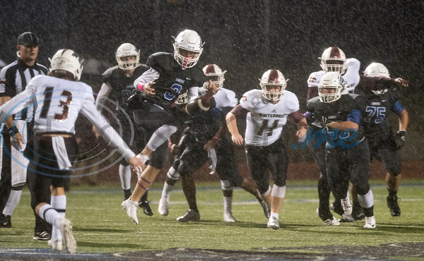 The ball slips by Lindale's (3) Conner Boyette in the rain during their football game against Whitehouse at Lindale on Friday Oct. 19, 2018.  (Sarah A. Miller/Tyler Morning Telegraph)