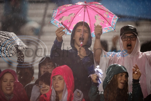Lindale football fans cheer in the rain as they play Whitehouse at home on Friday Oct. 19, 2018.  (Sarah A. Miller/Tyler Morning Telegraph)