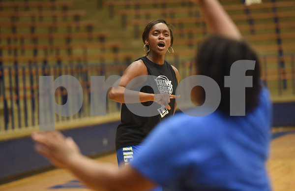 New John Tyler High School basketball coach Carlesa Dixon works with her team during practice Wednesday Oct. 19, 2016.  The Lady Lions return four starters from last year's district championship team.   (Sarah A. Miller/Tyler Morning Telegraph)