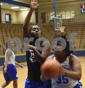 New John Tyler High School basketball coach Carlesa Dixon, left, works with player J'Kimbria Criss during practice Wednesday Oct. 19, 2016.  The Lady Lions return four starters from last year's district championship team.   (Sarah A. Miller/Tyler Morning Telegraph)