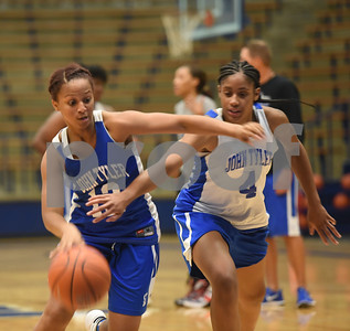 Alyssa Mayfield tries to get the ball from Zakiyah Jones as she dribbles during practice Wednesday Oct. 19, 2016.  The Lady Lions return four starters from last year's district championship team.   (Sarah A. Miller/Tyler Morning Telegraph)