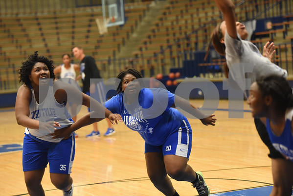 Shakera Lee, center, guards J'Kimbria Criss during practice Wednesday Oct. 19, 2016.  The Lady Lions return four starters from last year's district championship team.   (Sarah A. Miller/Tyler Morning Telegraph)