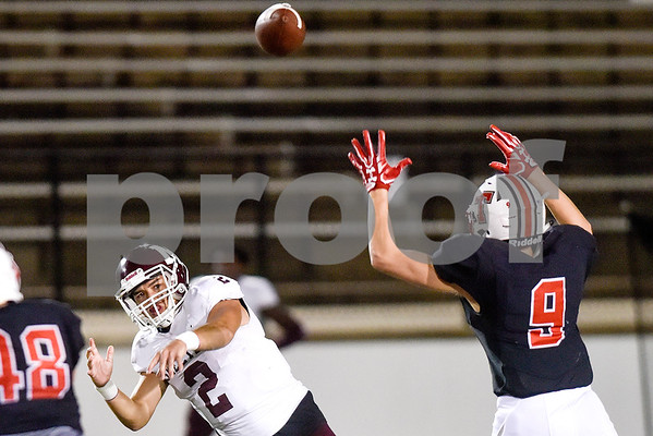 Mesquite quarterback Jonathan Garza (2) passes the ball as Robert E. Lee defensive back Carey Clark (9) jumps to attempt to block the pass during a high school football game at Christus Trinity Mother Frances Rose Stadium at Tyler, Texas, on Friday, Oct. 20, 2017. (Chelsea Purgahn/Tyler Morning Telegraph)