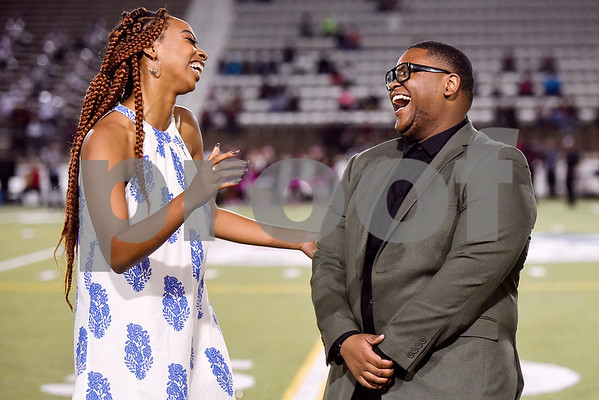 Jaylah Stegall and Bobby Manning react to winning homecoming queen and king during a high school football game at Christus Trinity Mother Frances Rose Stadium at Tyler, Texas, on Friday, Oct. 20, 2017. (Chelsea Purgahn/Tyler Morning Telegraph)