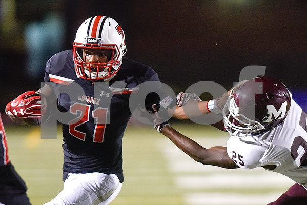 Robert E. Lee running back Ladarius Wickware (21) runs the ball as Mesquite  defensive back Desmond Hall (25) attempts a tackle during a high school football game at Christus Trinity Mother Frances Rose Stadium at Tyler, Texas, on Friday, Oct. 20, 2017. (Chelsea Purgahn/Tyler Morning Telegraph)