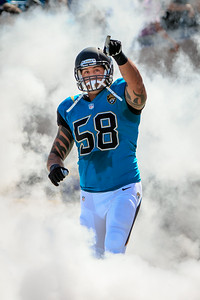 October 20, 2013 - Jaguars DE Jason Babin runs onto the field before the Jaguars take on the San Diego Chargers at Everbank Field. -James Vernacotola