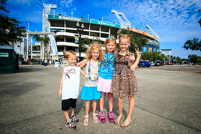 October 20, 2013: A few young fans outside the stadium before the Jaguars vs. Chargers game at Everbank Field. -James Vernacotola