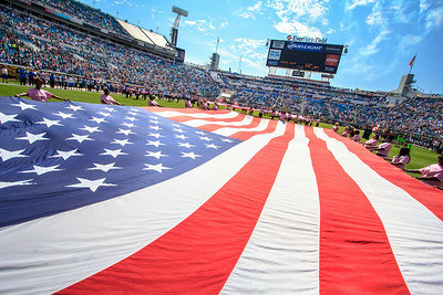 October 20, 2013 - Breast Cancer survivors carry the flag for the National Anthem before the Jaguars take on the San Diego Chargers at Everbank Field. -James Vernacotola