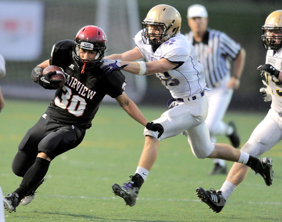 Fairview's Ben Meyer (left) slips past Boulder's Andrew Kurtz (right) during their football game at Recht Field in Boulder, Colorado October 21, 2011.  CAMERA/Mark Leffingwell