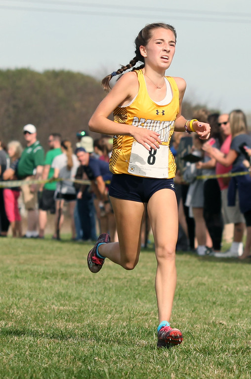 . Addison Ciecierski of Beaumont sprints to the finish in first during the Division II race. Randy Meyers -- The Morning Journal