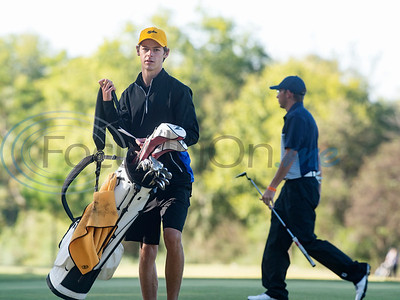 Tyler Junior College's Cade Basson picks up his bag after putting during their golf tournament at Pine Springs Golf Club on Monday Oct. 21, 2019.  (Sarah A. Miller/Tyler Morning Telegraph)