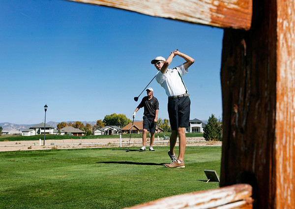 Samuel Toillion of Niwot High School tees off during the second round of the Colorado High School Activities Association's 4A State Golf Championship at The Links at Cobble Creek in Montrose, Colo., Tuesday, Oct. 2, 2012.<br /> <br /> Photo by Barton Glasser