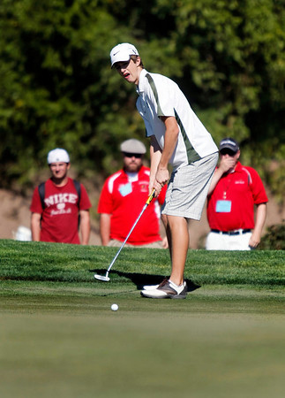 Luke Toillion of Niwot High School misses a putt during the second round of the Colorado High School Activities Association's 4A State Golf Championship at The Links at Cobble Creek in Montrose, Colo., Tuesday, Oct. 2, 2012.<br /> <br /> Photo by Barton Glasser