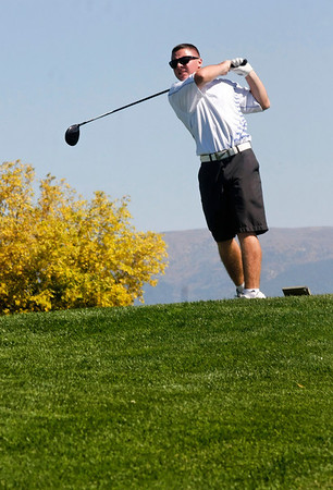 Matt Ayers of Longmont High School tees off during the second round of the Colorado High School Activities Association's 4A State Golf Championship at The Links at Cobble Creek in Montrose, Colo., Tuesday, Oct. 2, 2012.<br /> <br /> Photo by Barton Glasser