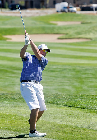 Bridger Ryan of Broomfield High School tees off during the second round of the Colorado High School Activities Association's 4A State Golf Championship at The Links at Cobble Creek in Montrose, Colo., Tuesday, Oct. 2, 2012.<br /> <br /> Photo by Barton Glasser