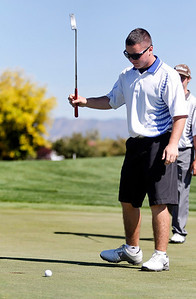 Matt Ayers of Longmont High School reacts after missing a putt during the second round of the Colorado High School Activities Association's 4A State Golf Championship at The Links at Cobble Creek in Montrose, Colo., Tuesday, Oct. 2, 2012.  Photo by Barton Glasser