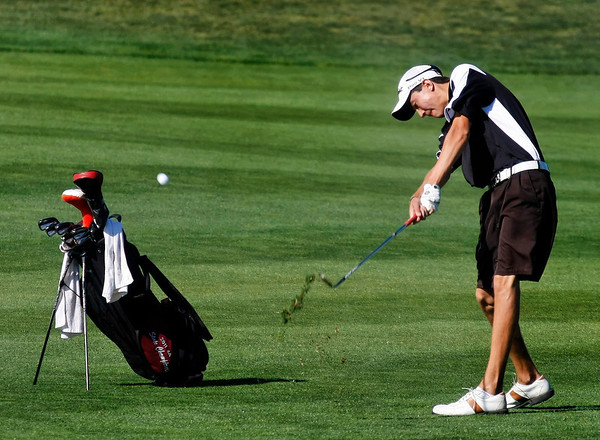 Jack Adolfson of Silver Creek High School hits from the fairway during the second round of the Colorado High School Activities Association's 4A State Golf Championship at The Links at Cobble Creek in Montrose, Colo., Tuesday, Oct. 2, 2012.<br /> <br /> Photo by Barton Glasser