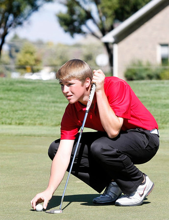 Nick Inslee of Centaurus High School lines up a putt during the second round of the Colorado High School Activities Association's 4A State Golf Championship at The Links at Cobble Creek in Montrose, Colo., Tuesday, Oct. 2, 2012.<br /> <br /> Photo by Barton Glasser